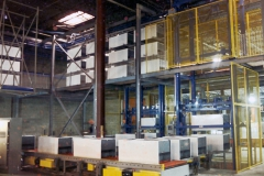 Feeding refrigerator cabinets to assembly line