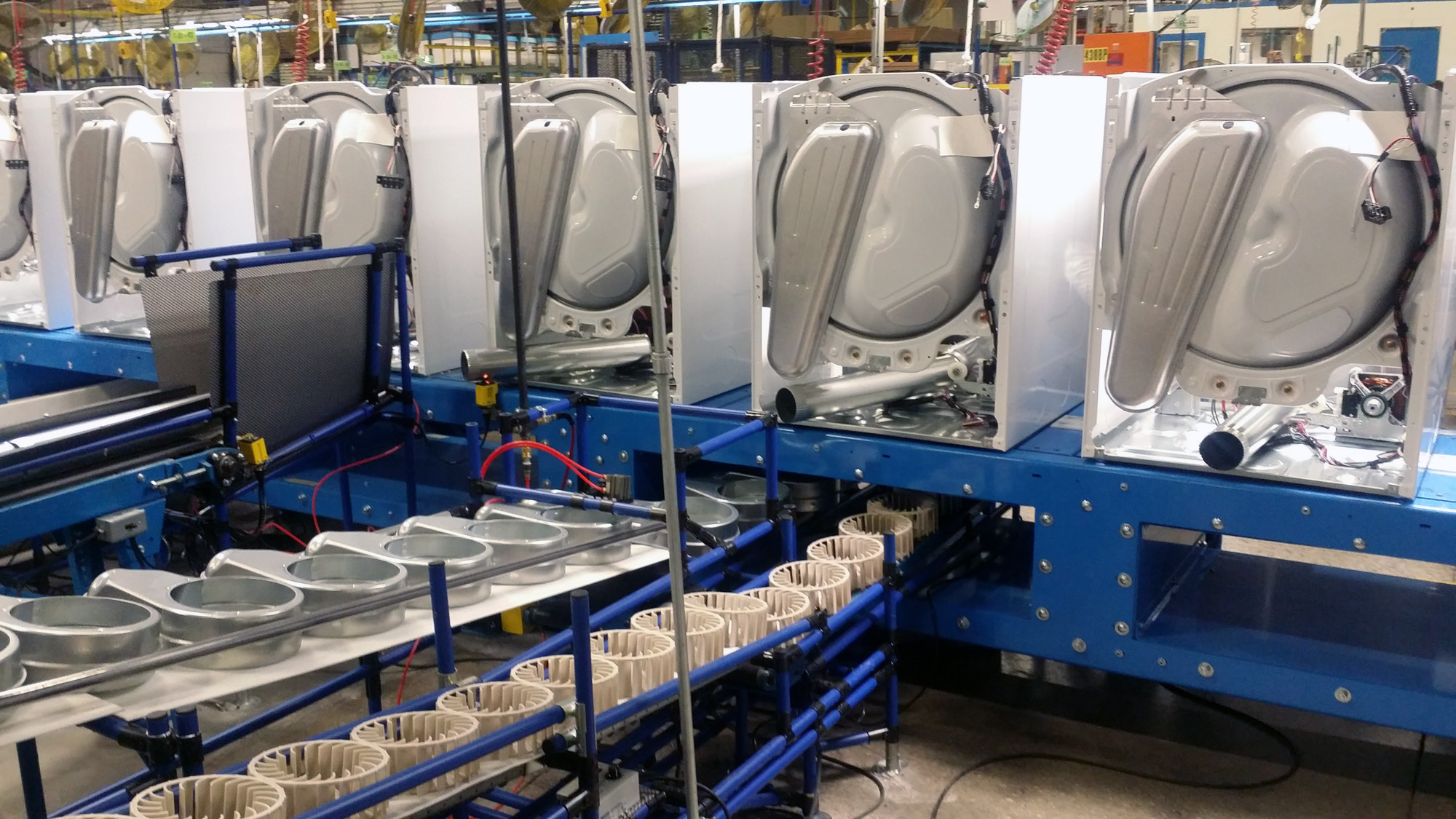 Dryer assembly line.  Slat with parts flow through deisgn